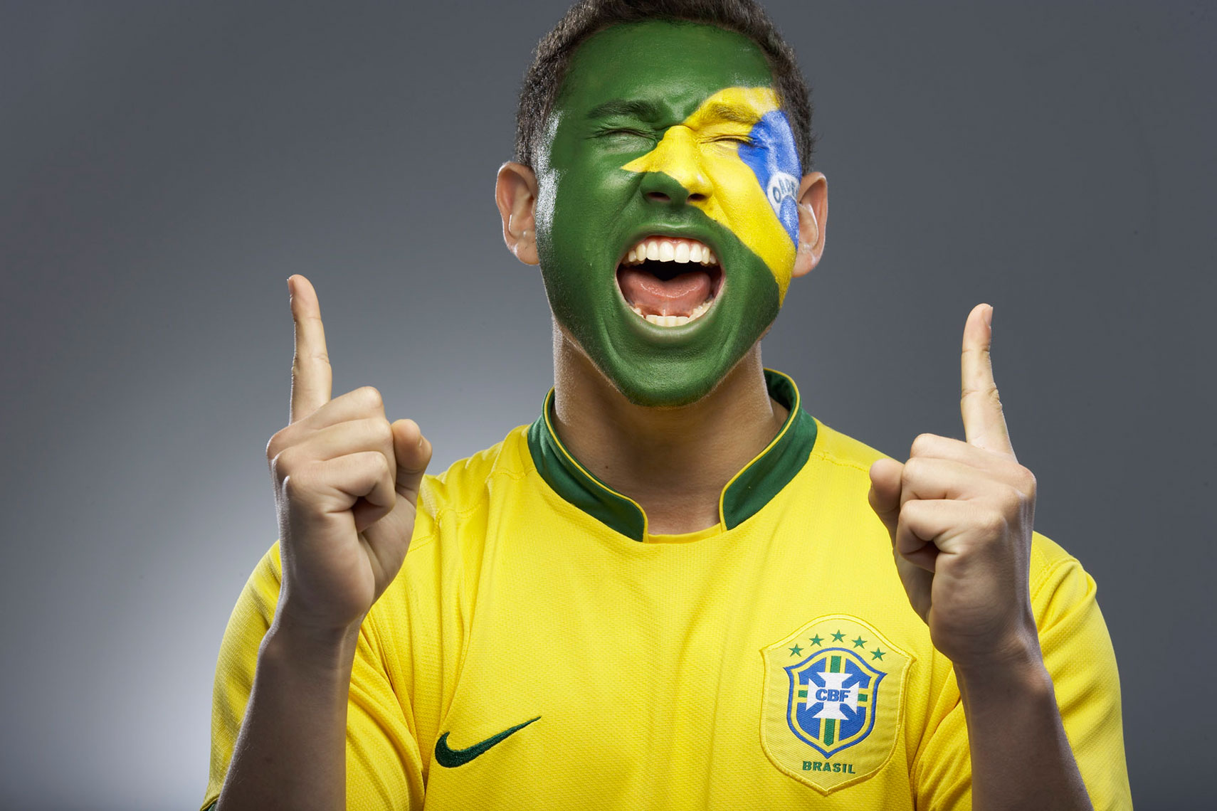 Brazilian Face Paint futbol football soccer fan photo by Monte Isom