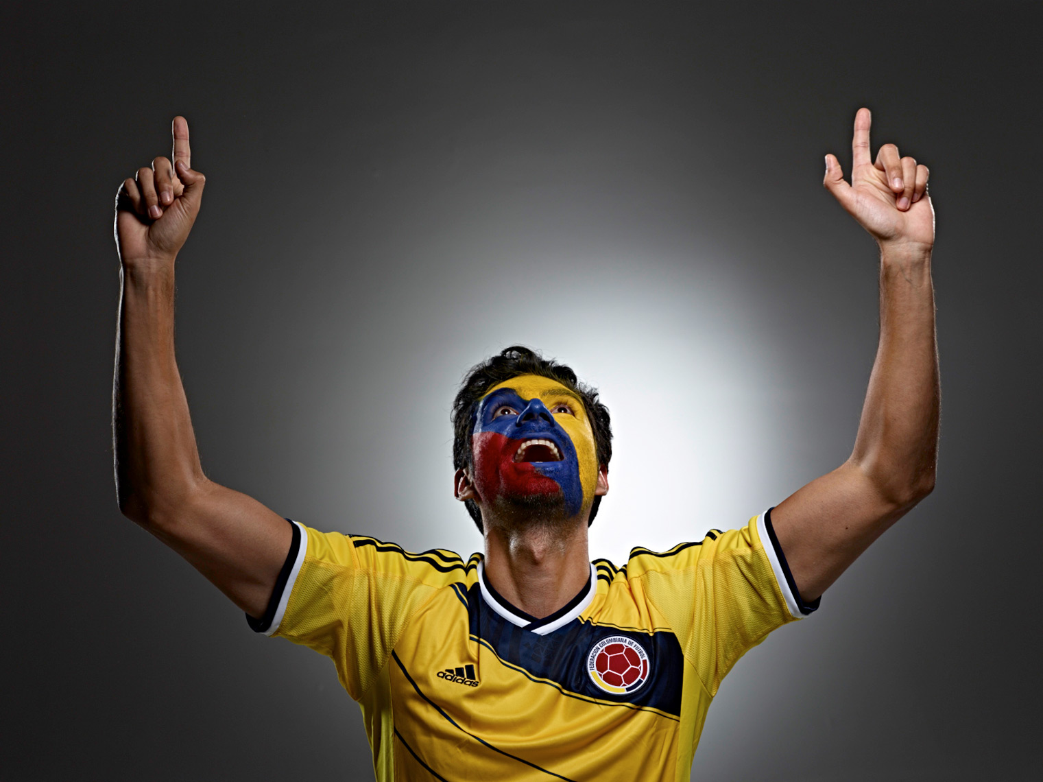 Colombian Futbol soccer fan face paint photo by Monte Isom