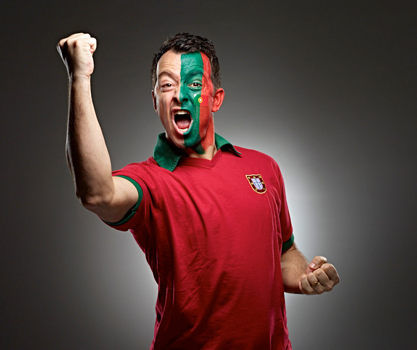 Portuguese Futbol soccer fan face paint photo by Monte Isom
